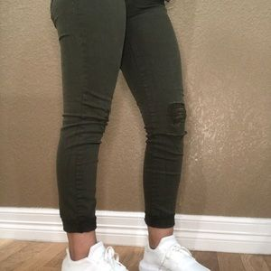 Distressed green jeggings